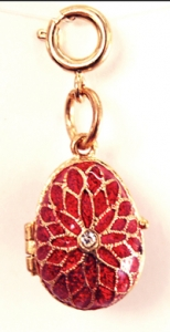 Flower cz center egg pendant/locket, measures 1 inch tall